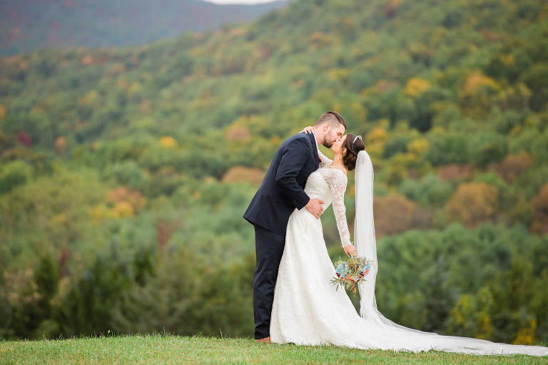 wedding couple kissing mountains