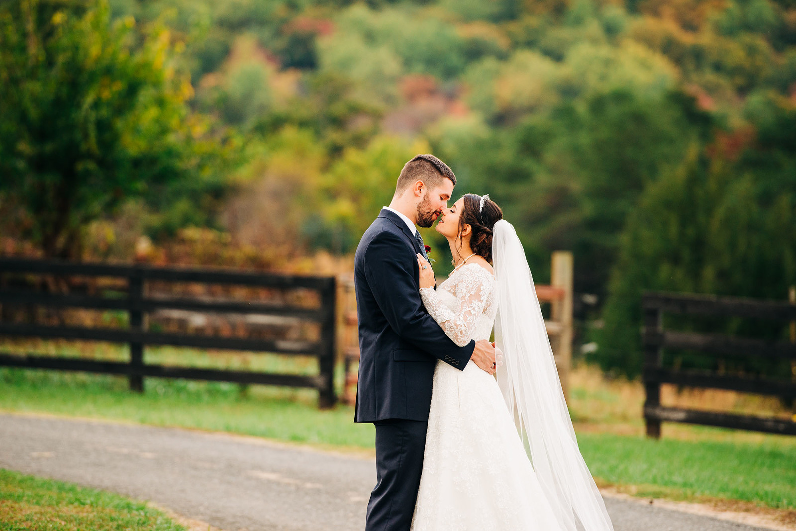 Wedding couple kissing at Lydia's Barn at Evermore Farm