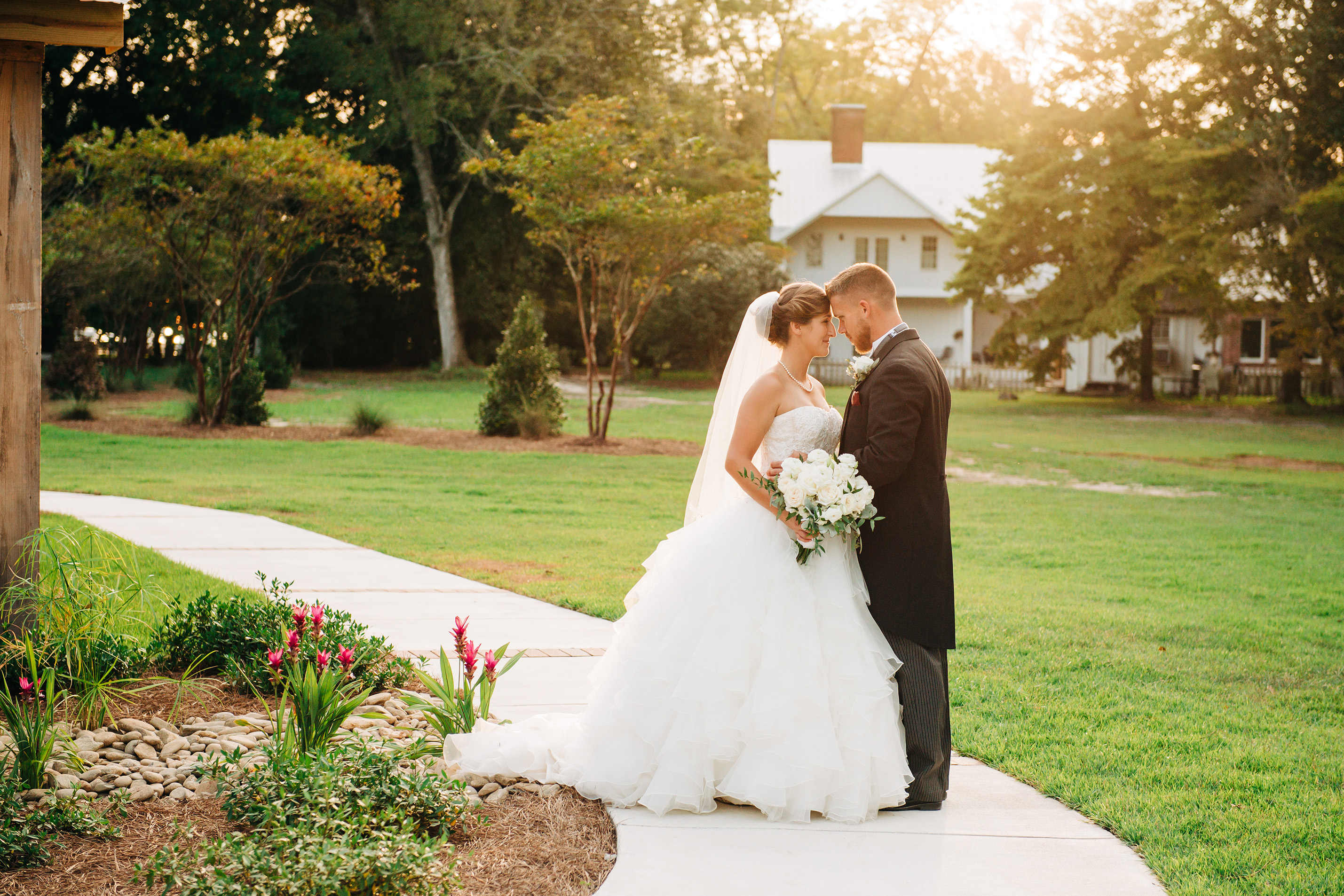 Wedding couple looking into each others eyes at Avirett Stephens Plantation in Richlands, North Carolina.