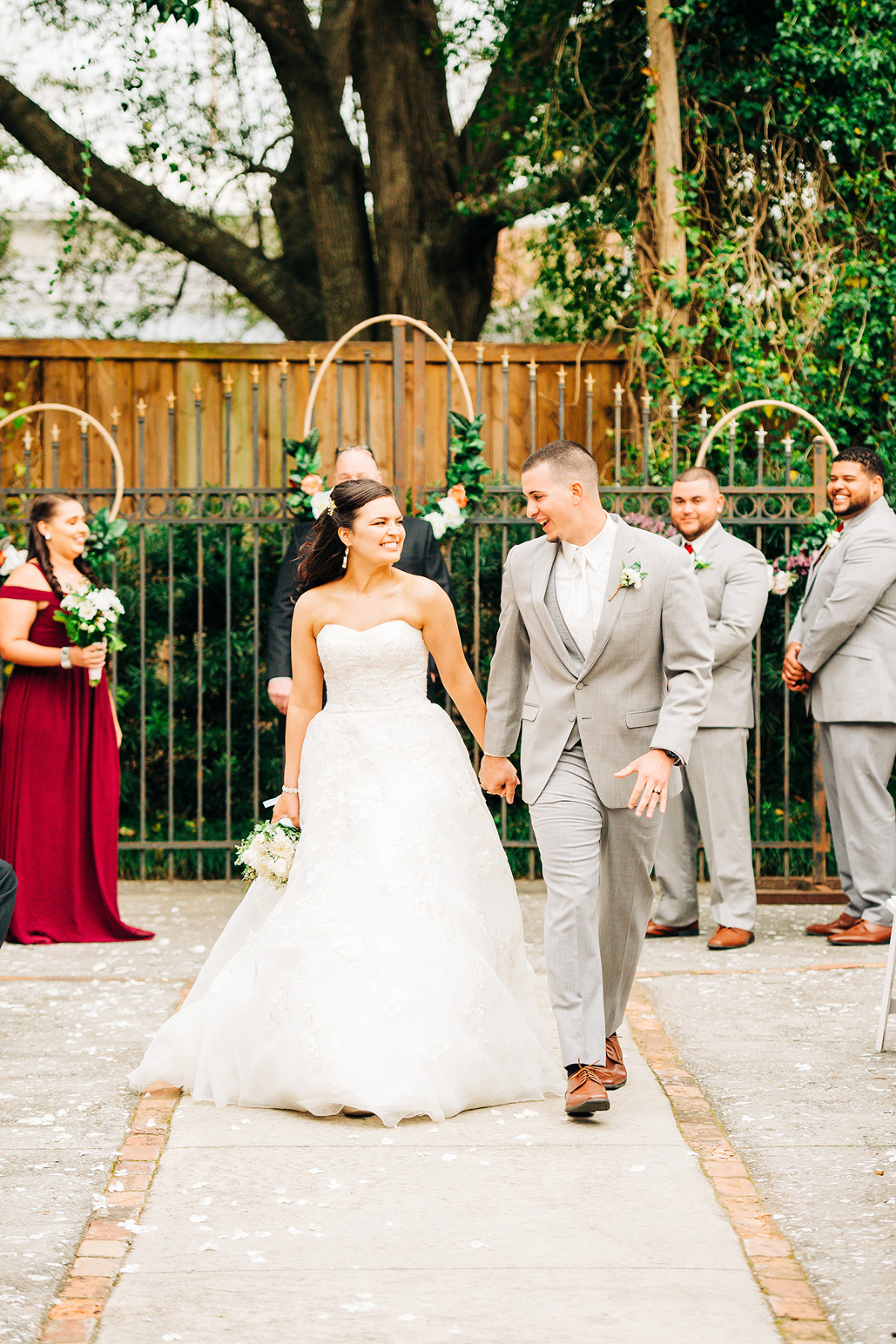 Wedding couple walking down the isle at Brooklyn Arts Center in Wilmington, North Carolina.